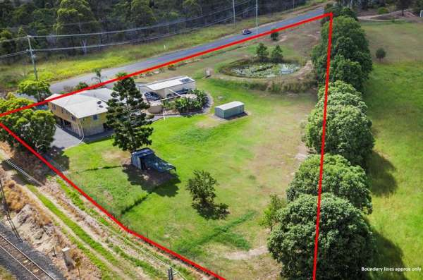 Commercial Investors Take Note!! Medium Industrial Zoned Land And House With 133m Of Road Frontage